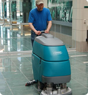 scrubbing floor with autoscrubber